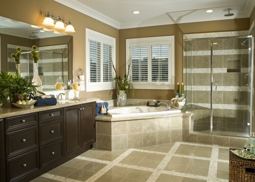 Considering a bathroom remodeling project? Consider swapping tile for metallic elements for a modern look.