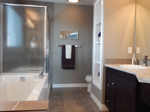 Separate your shower with frosted glass panels for privacy.