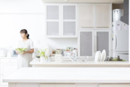 White kitchen cabinets can look unique with glass panels included.