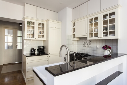 White kitchen cabinets with glass panels can help create a farmhouse feel to your kitchen